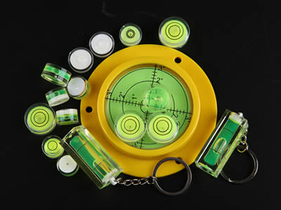 There are five plastic circular bubble level vials and four plastic tubular bubble level vials in different sizes.